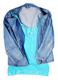 Woman`s coat. Jeans woman`s coat and blue top. Isolated white Stock Images