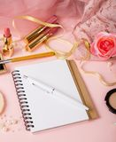 Woman`s cosmetics and diary. royalty free stock photography