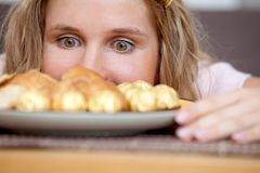Woman's cravings Royalty Free Stock Image