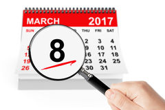 Woman`s Day Concept. 8 march 2017 calendar with magnifier Stock Photography