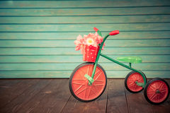 Woman`s day concept. Vintage bike with bouquet of tulips against wood background. Woman`s day. 8 March. Spring holiday concept Royalty Free Stock Photography