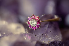 Woman's diamond ring. On Ametyst Royalty Free Stock Photography