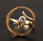 A woman's diamond wedding ring. Seen through a man's gold band Stock Image