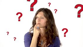 A woman's doubts. Woman on white background in a conceptual footage. She has many problems but no solutions stock footage