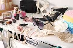 Woman`s dressing table with cosmetics set. And fashion accessories stock photo