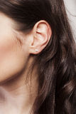 Woman's ear close up Royalty Free Stock Photo