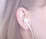 Woman`s ear with headphone Royalty Free Stock Photography