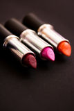 A woman's essential, lipsticks. A still life of some colourful lipsticks Royalty Free Stock Image