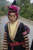 Woman's ethnic La Chi. On the road a couple and their baby will travel 20 km walk to the wedding of a neighbor. They left at night to arrive before noon. If the Royalty Free Stock Photo