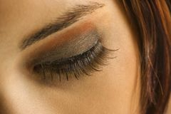 Woman's eye. Close up of young Caucasian woman's eye with makeup royalty free stock photography