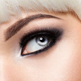 Woman's eye with black eye makeup. Macro style image Stock Photo