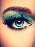 Woman's eye with green eye make-up. Royalty Free Stock Photography