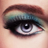 Woman's eye with green make-up. Long eyelashes. Woman's eye with green eye make-up. Long eyelashes stock image