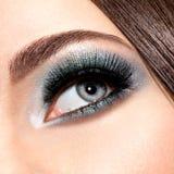 Woman's eye with turquoise makeup. Long false eyelashes. macro s Royalty Free Stock Image