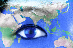 Woman's eye with world Stock Photo