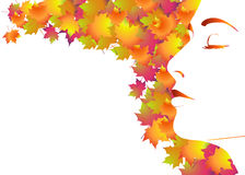 Woman's face with autumn leaves Stock Image