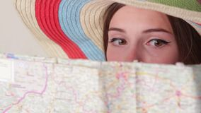 Woman's face behind a map. stock video footage