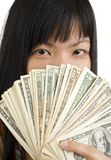 Woman's face behind money Stock Photography