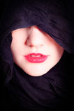Woman\'s face with black hood Stock Photography