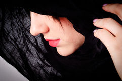 Woman\'s face with black hood Stock Image
