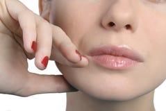 Woman's face closeup. Touching lips Stock Photos