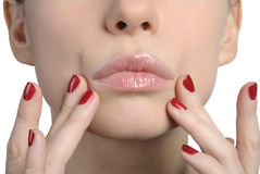 Woman's face closeup. Fingers touching Stock Images