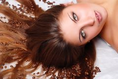 Woman's face with coffee beans stock photos