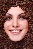 Woman's face with coffee  beans Royalty Free Stock Image