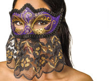 Woman's face concealed Venetian mask Stock Photography