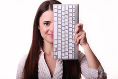Woman's face covered keyboard isolated on white Royalty Free Stock Image