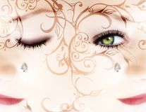 Woman?s face with a diamond and scrolls royalty free illustration