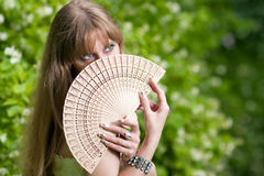 Woman's face and fan Stock Photography