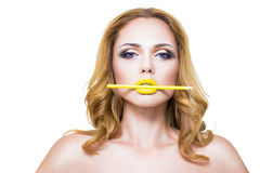 Woman's face with fashion yelow lips make-up Stock Image