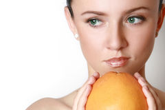 Woman's face with grapefruit Royalty Free Stock Photos