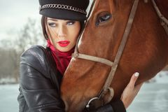 Woman`s face and the horse`s head close up stock photography