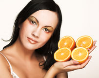 Woman's face with juicy orange Royalty Free Stock Photography