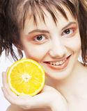 Woman's face with juicy orange Stock Image