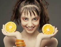 Woman's face with juicy orange Stock Images