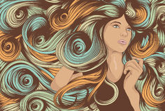 Woman's face with long detailed hair. Beautiful woman with long colorful swirling hair Stock Photography