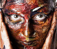 A woman's face in oil paints Stock Image