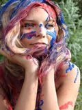 Woman's face in paint Stock Photography