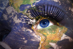 Woman`s face with planet Earth texture and european union flag i. Nside the eye. Elements of this image furnished by NASA Stock Photos