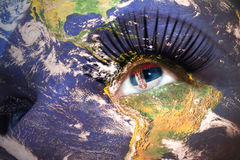 Woman`s face with planet Earth texture and serbian flag inside the eye. Elements of this image furnished by NASA stock photo