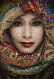 Woman's face shrouded by head scarf Royalty Free Stock Photos