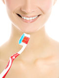 Woman's face with a toothbrush Royalty Free Stock Images