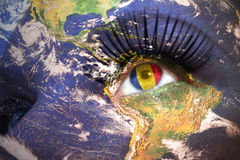 Woman`s Face With Planet Earth Texture And Romanian Flag Inside The Eye. Royalty Free Stock Photography