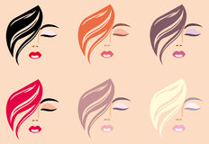 Woman's faces. With hair of different colour Royalty Free Stock Photography