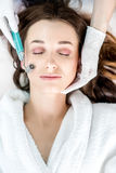 Woman`s facial treatment stock photography