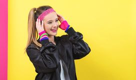 Woman in 1980`s fashion theme. On a split yellow and pink background stock images