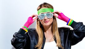 Woman in 1980`s fashion. On a white background Royalty Free Stock Images